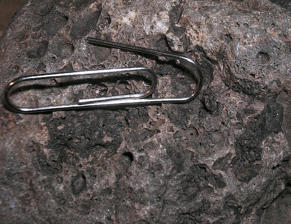 chiemite on vesicular Muschelkalk cobble, Saarland meteorite impact site